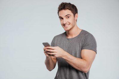 handsome man texting