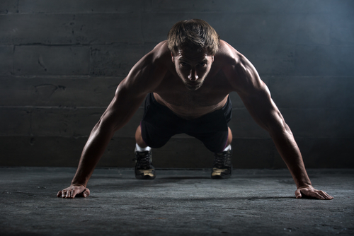 muscular guy doing push up is stronger with Progentra