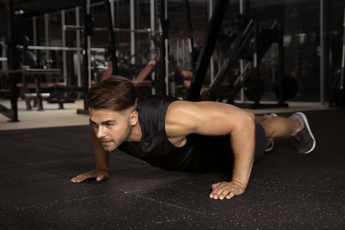 fit man doing push up have more energy with Progentra