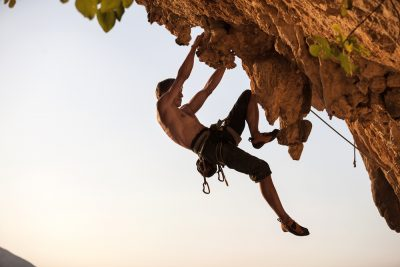 fit man rock climbing