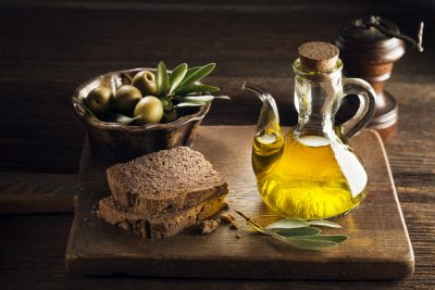 olive oil and whole grain bread, green olives