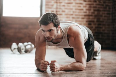 fit man doing planks is stronger with Progentra