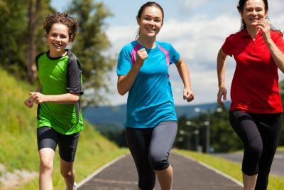 mom running with teenage kids