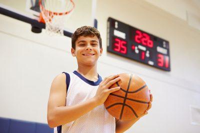 teenaged boy playing basketball