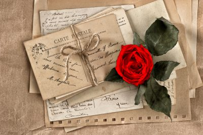 old love letters and a single red rose