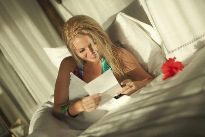woman happily reads love letter from husband who uses Progentra